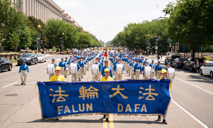 Falun Gong practitioners take part in a parade marking the 22nd anniversary of the start of the Chinese regime's persecution of Falun Gong, in Washington on July 16, 2021. (Larry Dye/The Epoch Times)