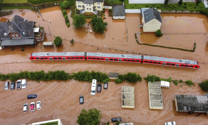 A regional train sits in the flood waters at the local station in Kordel, Germany, on July 15, 2021. (Sebastian Schmitt/dpa via AP)