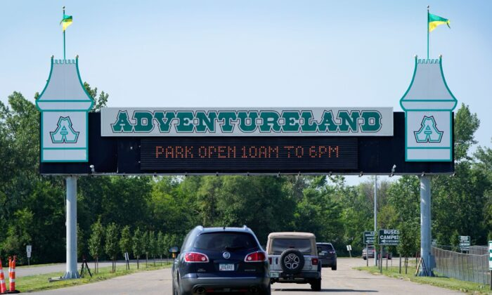 Visitors arrive at the Adventureland Park amusement park, in Altoona, Iowa on July 6, 2021. (Charlie Neibergall/AP Photo)