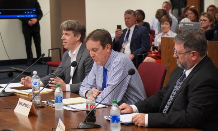(L-R) Doug Logan, CEO of Cyber Ninjas, the firm leading Arizona's vote audit in Maricopa County, gives testimony on preliminary findings at a Senate hearing, sitting beside Arizona Senate audit liason Ken Bennett, and Ben Cotton, the founder of digital security firm called CyFIR LLC, in Phoenix, Ariz., on July 16, 2021. (Allan Stein/Epoch Times)