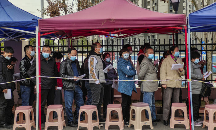 Residents line up to receive the COVID-19 vaccine at a community hospital in Wuhan, Hubei Province, China, on March 23, 2021. (Getty Images)