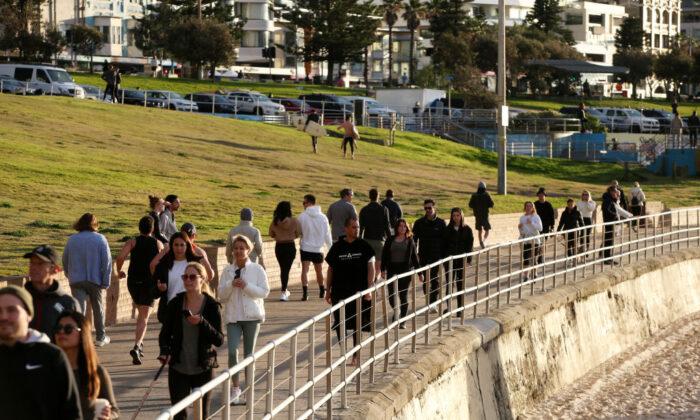 People are seen walking along the Bondi Beach boardwalk in Sydney, Australia on July 14, 2021. (Lisa Maree Williams/Getty Images)