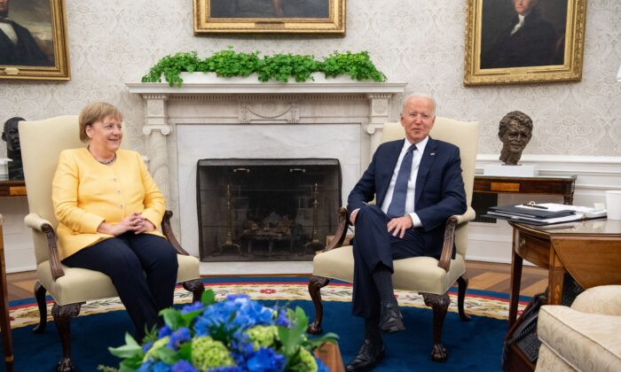President Joe Biden and German Chancellor Angela Merkel holda a meeting in the Oval Office of the White House in Washington, on July 15, 2021. (Saul Loeb/AFP via Getty Images)