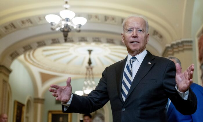 President Joe Biden speaks with reporters after meeting with Senate Democrats at the Capitol in Washington on July 14, 2021. (Andrew Harnik/AP Photo)