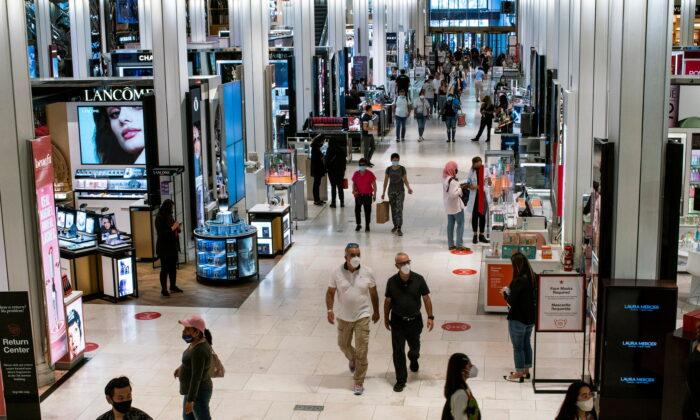 Customers visit Macy's flagship store in New York City, N.Y., on May 20, 2021. (Eduardo Munoz/Reuters)