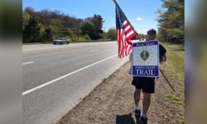 Veterans' Advocate Hikes New 'Purple Heart Trail' in the Rain With Huge American Flag in Rhode Island