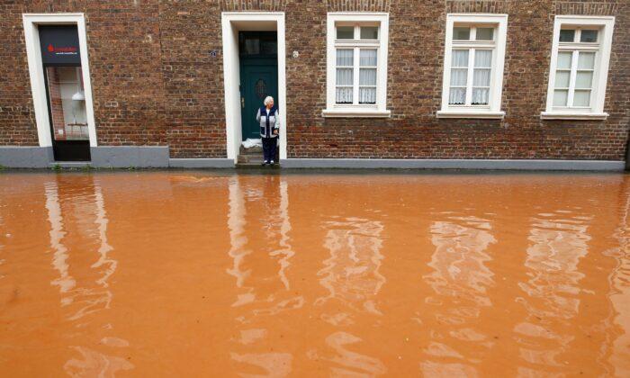A street is flooded following heavy rainfalls in Erftstadt, Germany, on July 16, 2021. (Thilo Schmuelgen/Reuters)