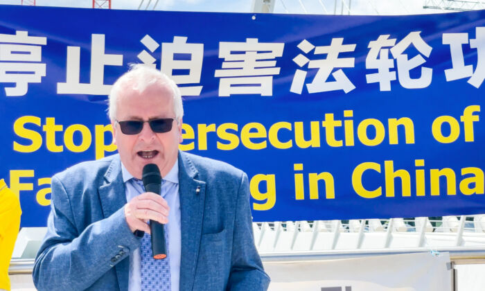Mattie McGrath, independent TD, speaks at a rally  marking the 22nd year of the persecution of Falun Gong in China, in Dublin, Ireland, on July 14, 2021. (Feng Yu/The Epoch Times)