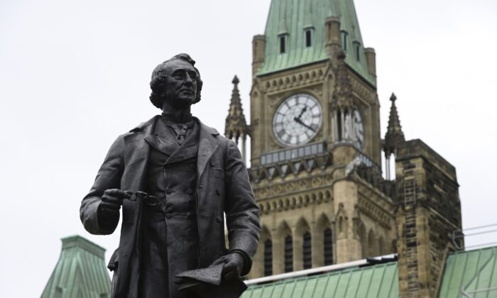 A statue of Canada's first prime minister Sir John A. Macdonald on Parliament Hill in Ottawa on June 3, 2021. (The Canadian Press/Sean Kilpatrick)