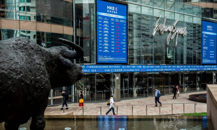 Electronic boards display various stock prices at Exchange Square in Hong Kong on March 9, 2020.  (Isaac Lawrence/AFP via Getty Images)