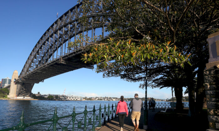 People are seen exercising along the Milsons Point boardwalk in Sydney, Australia on July 16, 2021. (Lisa Maree Williams/Getty Images)