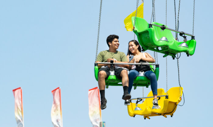 People enjoy opening day of the Orange County Fair in Costa Mesa, Calif., on July 16, 2021. (John Fredricks/The Epoch Times)