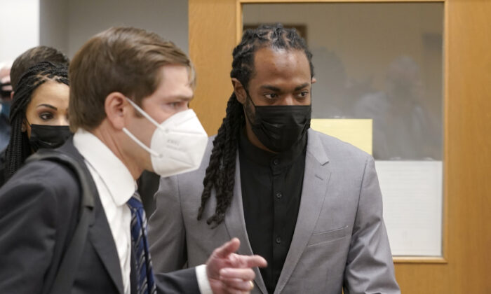 NFL football player Richard Sherman (R) heads into a hearing at King County District Court with his attorney Cooper Offenbecher, in Seattle, Wash., on July 16, 2021. (Ted S. Warren/AP Photo)