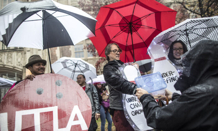 Teachers, students, friends and family protest and picket in the pouring rain outside John Marshall High School during a United Teachers Los Angeles strike in Los Angeles, Calif., on Jan. 14, 2019. (Barbara Davidson/Getty Images)
