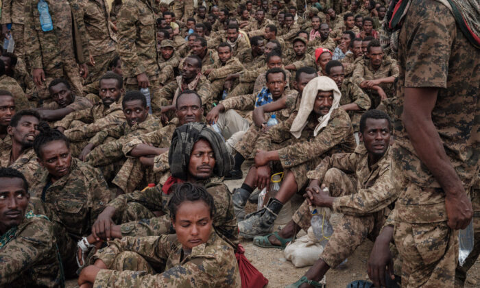 Captive Ethiopian soldiers arrive at the Mekele Rehabilitation Center in Mekele, the capital of Tigray region, Ethiopia, on July 2, 2021. (Yasuyoshi Chiba/AFP via Getty Images)