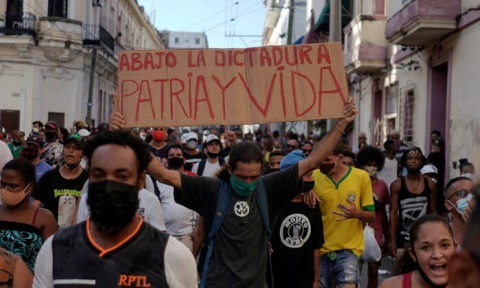 People shout slogans against the communist regime during a protest in Havana, Cuba, on July 11, 2021. (Alexandre Meneghini/Reuters)