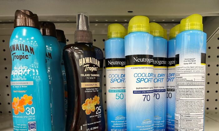 Johnson & Johnson's Neutrogena Cool Dry Sport sunscreen, which is part of a voluntary recall of five Neutrogena and Aveeno brand aerosol sunscreen products after a cancer-causing chemical was detected in some samples, sits on a shelf at a store in Gloucester, Mass., on July 15, 2021. (Brian Snyder/Reuters)