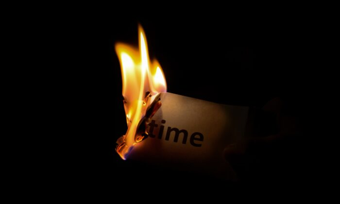 The word time can be seen on a piece of paper that is burning, illustrating managing the time. (Pexels/Pixabay)