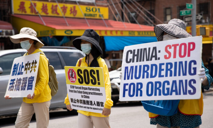 Falun Gong practitioners take part in a parade marking the 22nd year of the persecution of Falun Gong in China, in New York on July 18, 2021. (Chung I Ho/The Epoch Times)