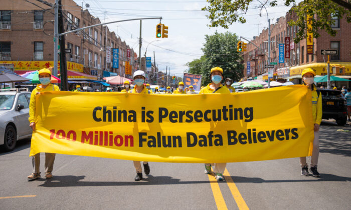 Falun Gong practitioners take part in a parade marking the 22nd year of the persecution of Falun Gong in China, in Brooklyn, N.Y., on July 18, 2021. (Chung I Ho/The Epoch Times)