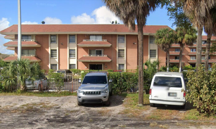 The three-story apartment building at 17500 NW 68th Ave in northwestern Miami-Dade County, Fla., in February 2021, before its roof partially collapsed. (Google Maps)