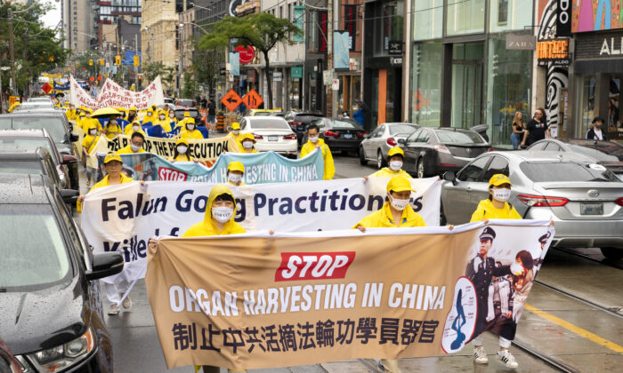 Falun Gong adherents parade through downtown Toronto on July 17, 2021, marking 22 years since Chinese Communist Party launched its campaign of persecution against the spiritual practice in China. (Evan Ning/The Epoch Times)