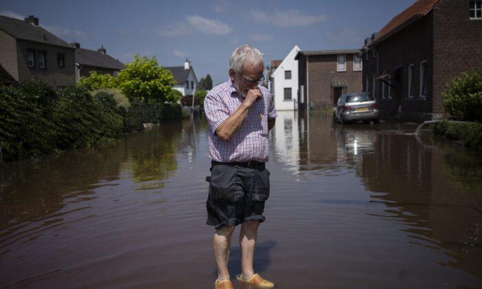 Wiel de Bie, 75,  stands outside his flooded home in the town of Brommelen, Netherlands,  Saturday, July 17, 2021. (Bram Janssen/AP Photo)