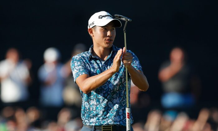 Collin Morikawa of the United States celebrates after holing his putt on the 18th green to win the British Open Golf Championship at Royal St George's golf course in Sandwich, England, on July 18, 2021. (Paul Childs/Reuters)