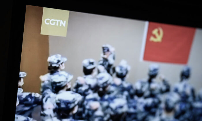 Scenes from a program from the CGTN archive are displayed on a computer monitor in London, England, on Feb. 04, 2021. Ofcom say that Star China Media Limited (SCML) who owns the licence for China Global Television Network (CGTN) doesn't have day-to-day editorial control over the channel, which is against its rules. (Leon Neal/Getty Images)
