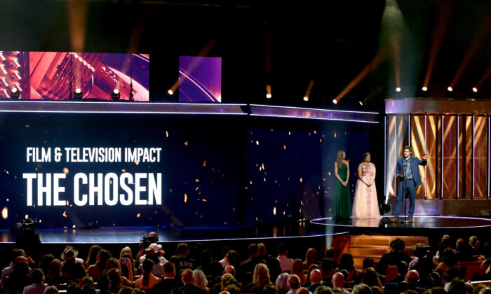 """Dallas Jenkins, producer of """"The Chosen,"""" accepts an award onstage for winning the Film and Television Impact award onstage during the 2021 K-LOVE Fan Awards in Nashville, Tennessee, on May 30, 2021. (Terry Wyatt/Getty Images for K-LOVE Fan Awards)"""