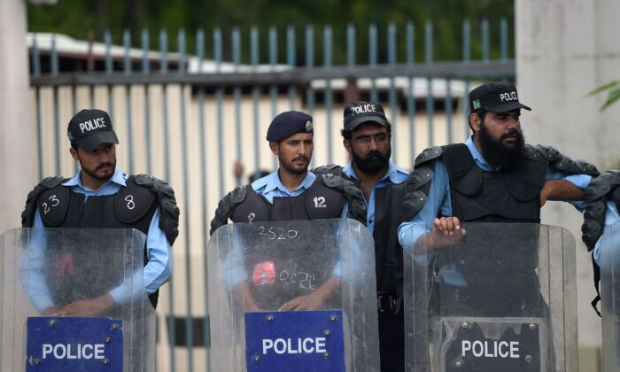 Pakistani policemen stand guard at the diplomatic enclave in Islamabad, Pakistan, in a file photo. (Aamir Qureshi/AFP via Getty Images)