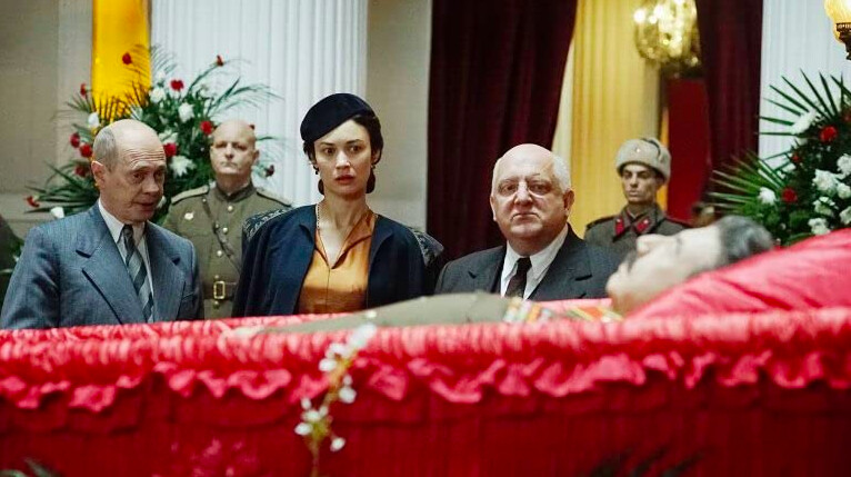 two men, one woman, and casket in The Death of Stalin