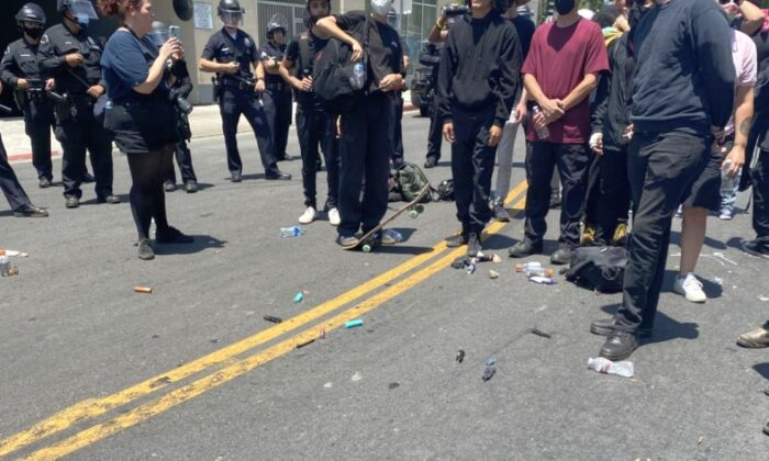 The LAPD said dozens of people were arrested amid protests and counter-protests at a Korean spa in Los Angeles on July 17. (LAPD HQ Twitter/ Screenshot via The Epoch Times)