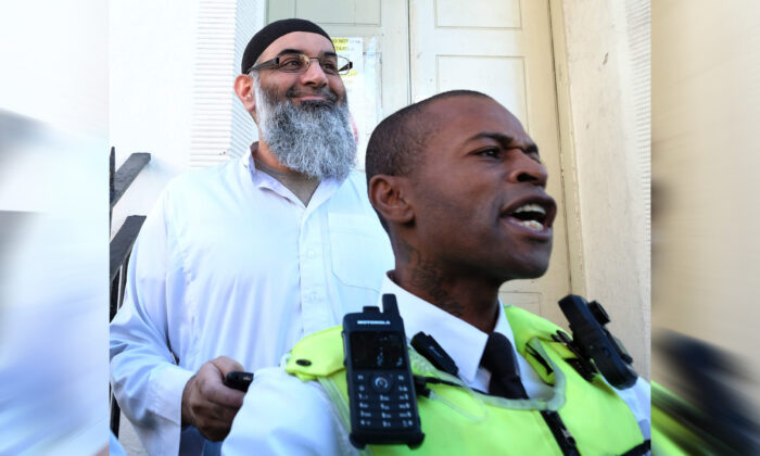 Anjem Choudary stands outside a bail hostel in north London after his release from Belmarsh Prison on Oct. 19, 2018. (David Mirzoeff/PA)