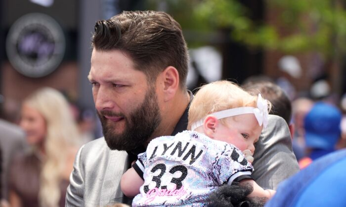 American League's Lance Lynn, of the Chicago White Sox, arrives with his daughter, Mia Jane Lynn, at the All Star Red Carpet event prior to the MLB All-Star baseball game, in Denver, on July 13, 2021. (David Zalubowski/AP Photo)