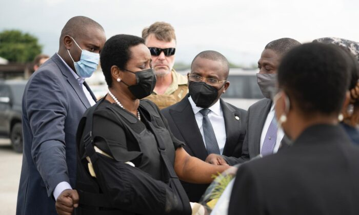 Haiti's First Lady Martine Moise, wearing a bullet proof vest and her right arm in a sling, arrives at the Toussaint Louverture International Airport, in Port-au-Prince, Haiti, on July 17, 2021. (Haiti's Secretary of State for Communication Photo/via AP)