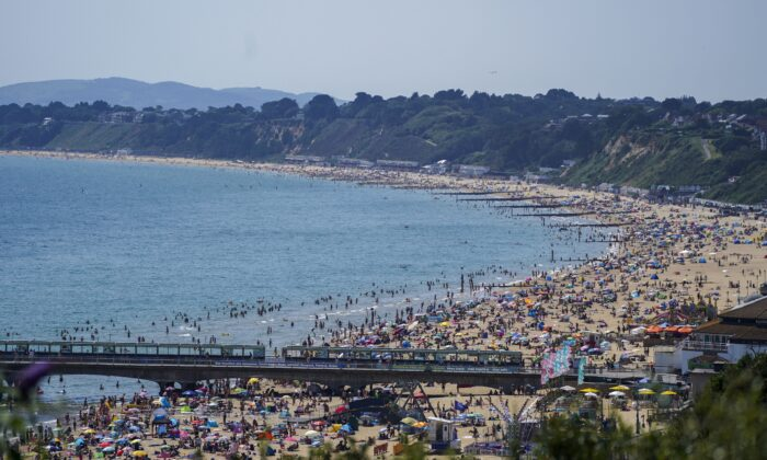 People enjoy the weather on Bournemouth beach in Dorset, Britain, on July 19, 2021. (Steve Parsons/PA)