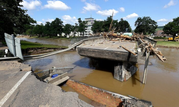 A damaged bridge with a missing part is pictured following heavy rainfalls in Bad Neuenahr-Ahrweiler, Germany, on July 18, 2021. (Wolfgang Rattay/Reuters)