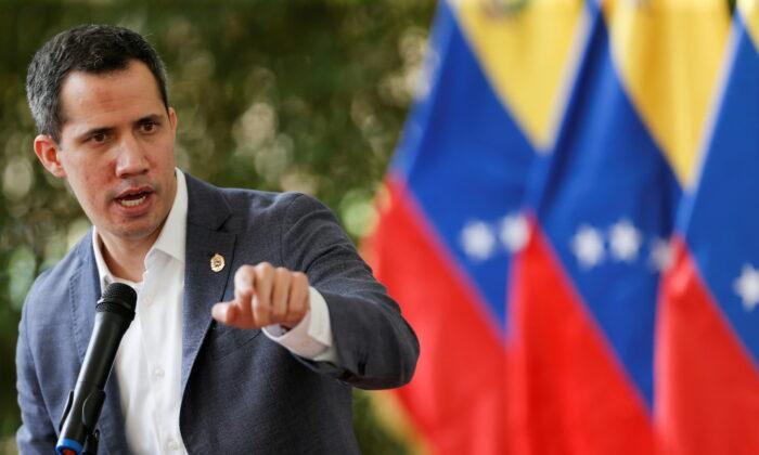 Venezuela's opposition leader Juan Guaido addresses the media, in Caracas, Venezuela, on April 9, 2021. (Manaure Quintero/Reuters)