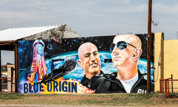 Mural displaying Jeff Bezo and his brother Mark Bezo, is seen in Van Horn, Texas, on July 18, 2021. (Thom Baur/Reuters)