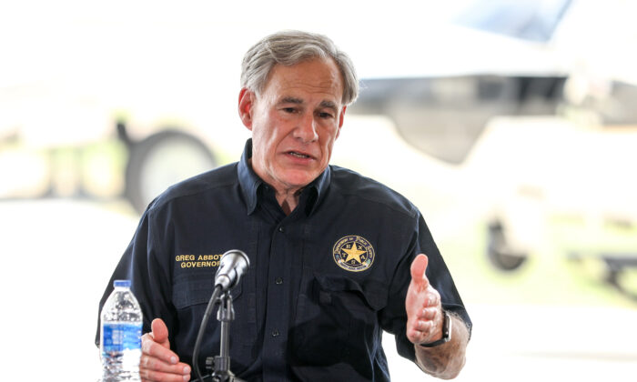 Texas Gov. Greg Abbott speaks during a border meeting in Del Rio, Texas, on July 18, 2021. (Charlotte Cuthbertson/The Epoch Times)