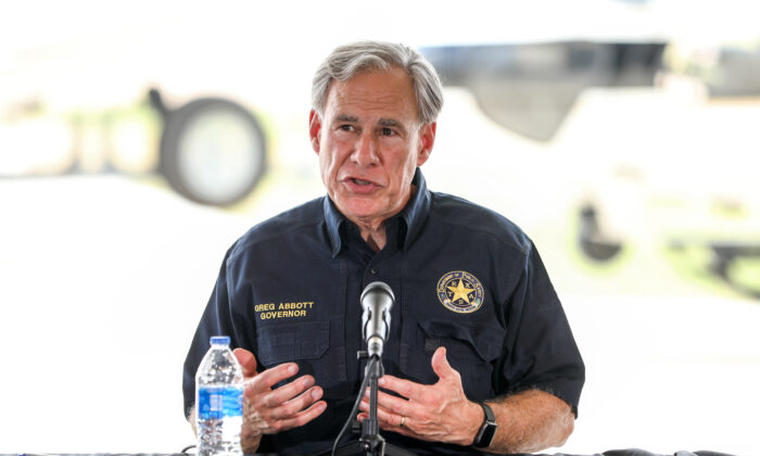 Texas Gov. Greg Abbott speaks at a border meeting in Del Rio, Texas, on July 18, 2021. (Charlotte Cuthbertson/The Epoch Times)