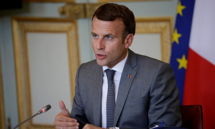French President Emmanuel Macron delivers his statement at the end of the 5th France-Oceania Summit, held via video-conference, at the Elysee Palace in Paris, France, on July 19, 2021. (Yoan Valat/Pool via Reuters)