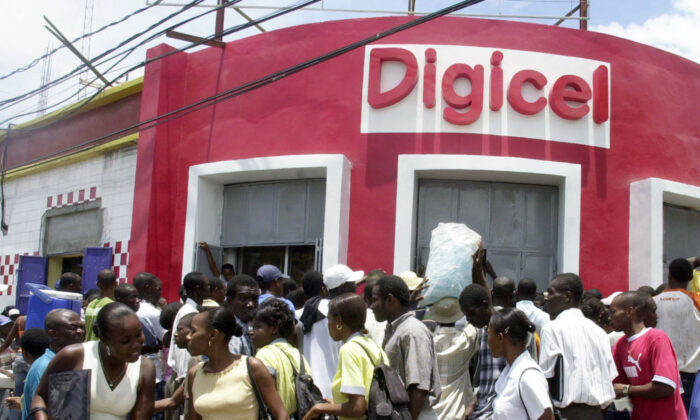 Haitians line up 05 May, 2006, at the DIGICEL office in Port-au-Prince to get new cellular phones and service. (Thony Belizaire/AFP via Getty Images)
