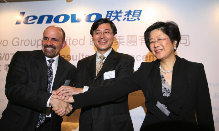 William J Amelio (L), president and CEO of Lenovo Group, Yang Yuanqing, chairman of Lenovo Group (C), and Mary Ma, senior VP and chief financial officer at a press conference in Hong Kong, on May 23, 2007. (Mike Clarke/AFP via Getty Images)