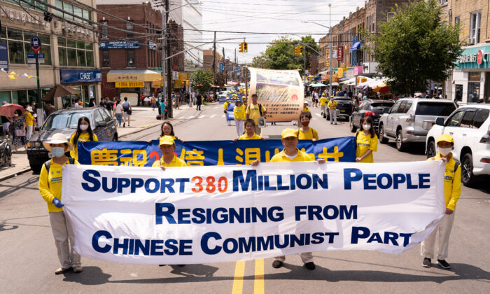 Falun Gong practitioners take part in a parade marking the 22nd year of the persecution of Falun Gong in China, in Brooklyn, N.Y., on July 18, 2021. (Larry Dye/The Epoch Times)