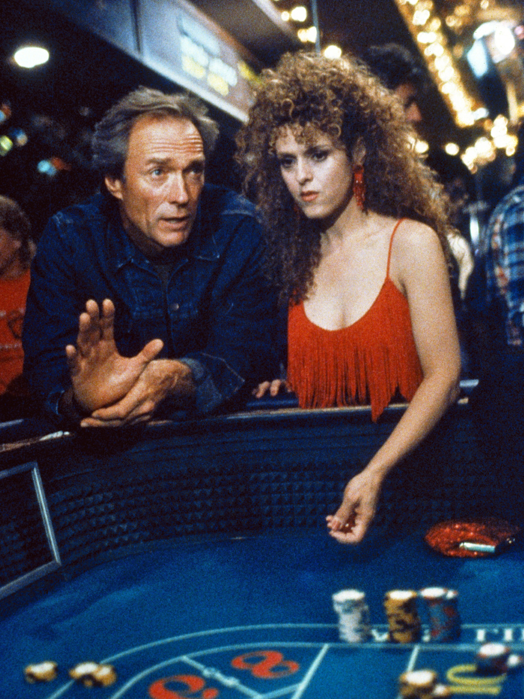 man and woman in casino in Pink Cadillac