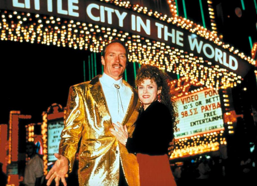 man in gold suit and woman in front of casino in Pink Cadillac