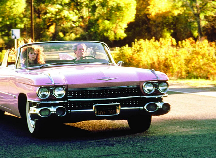 man and woman in a pink cadillac in Pink Cadillac