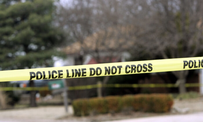 Police tape in a file photo. (Larry W. Smith/Getty Images)